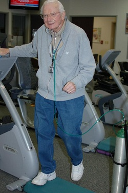 Stepping up and down helps strengthen Frank Kaspar's lung function.